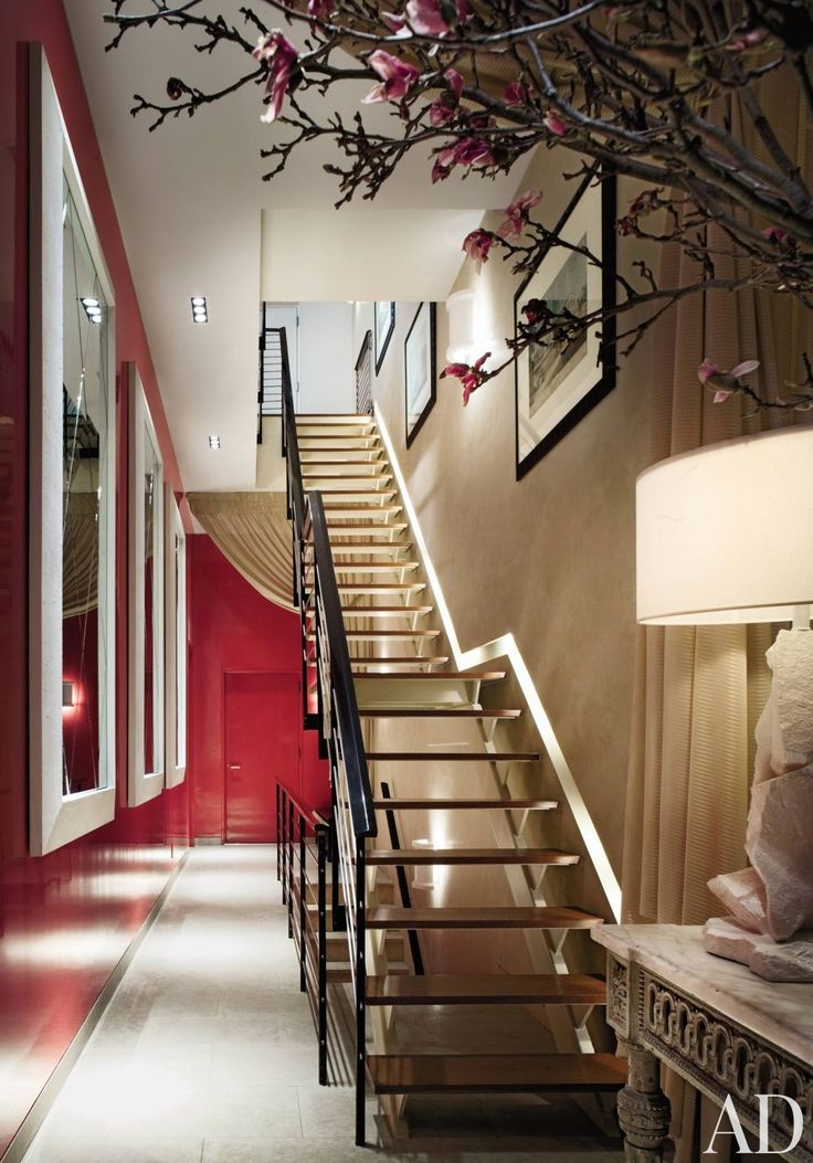 Coral high-gloss walls and a trio of mirrors establish a sense of intimacy in a imposing entrance hall.Beautiful Modern Home, Red And White, Modern Home Design, Thomas Britt, Interiors Design, Entrance Hall, Staircas, White Colors, Colors Inspiration