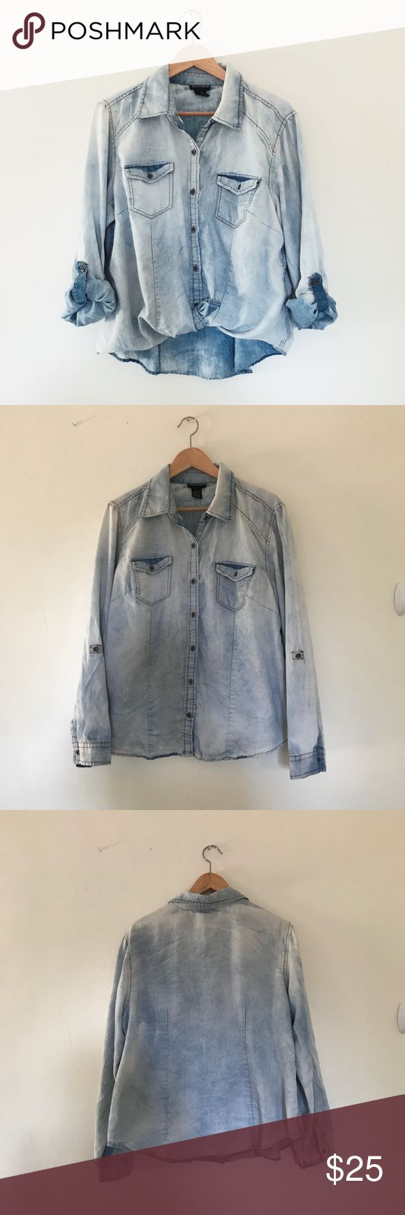 Distressed Button Down Acid Wash Distressed Button Down shirt in good preowned condition. This is a plus size shirt, about the same as a large, but I wear it as an oversized slouchy fit. Super cute tucked into high-waisted skinny jeans Cotton Express Tops Button Down Shirts