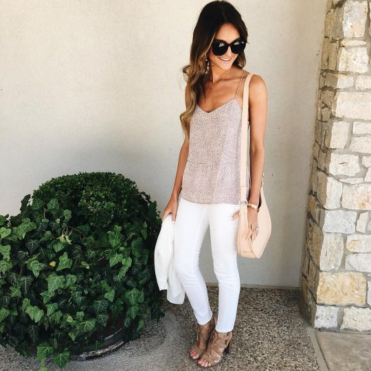 white jeans, cotton tank top, scrappy sandals and a nude purse. What a chic and understated outfit!