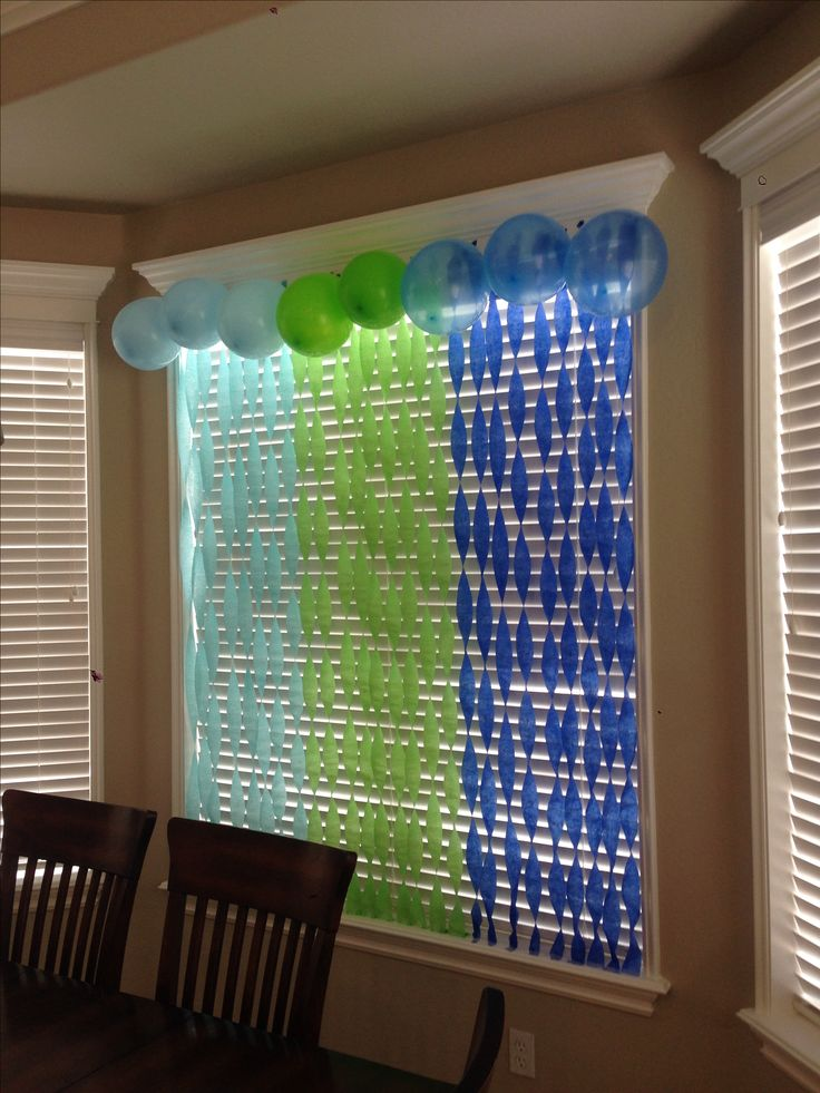 Hang streamers on the wall or window and twist them then add balloons at the top for birthday decorations.