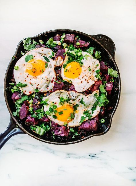 purple sweet potato and kale hash with fried eggs