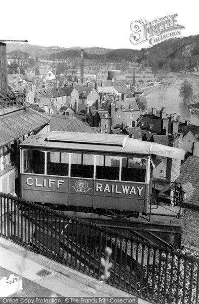 Bridgnorth, The Cliff Railway c.1955, from Francis Frith. The railway was originally worked by a water-balance system, but this was eventually replaced with colliery winding equipment. The poet and railway buff Sir John Betjeman likened a trip upon the cliff railway to a journey to heaven. #transportheritage #Bridgnorth #cliffrailway