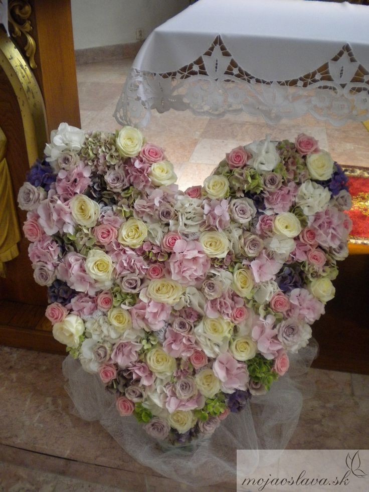 big heart with hydrangea and roses in wedding church