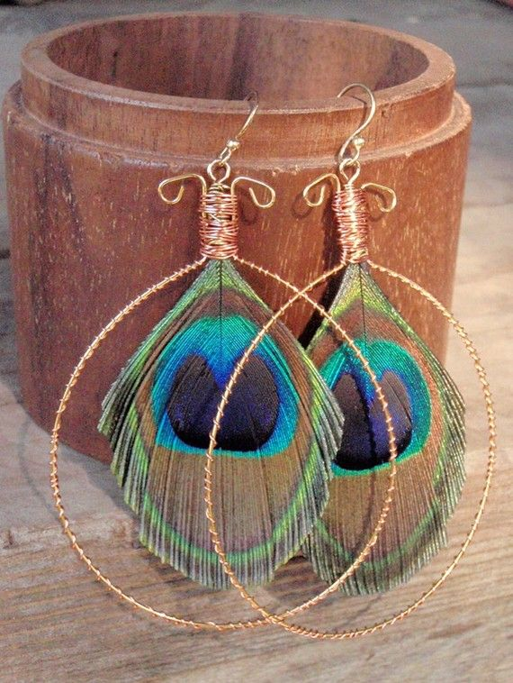 I love the bright jewel colours of the bright peacock feathers with copper wire they come together to create a unique pair of handcrafted earrings