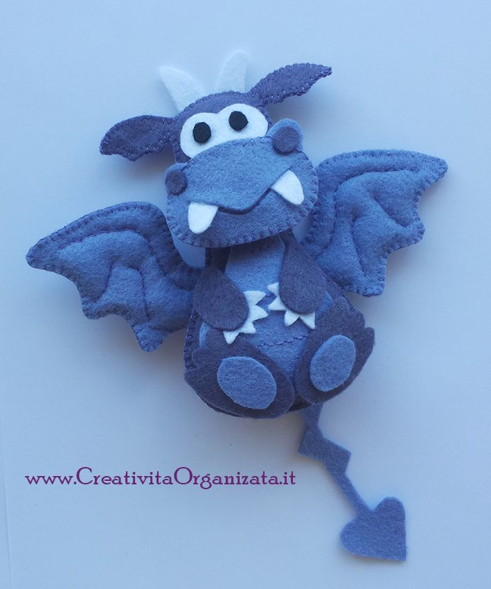 Felt dragon free pattern http://www.creativitaorganizzata.it/2014/08/05/cartamodello-draghetto-in-pannolenci-di-handmadebyoby/