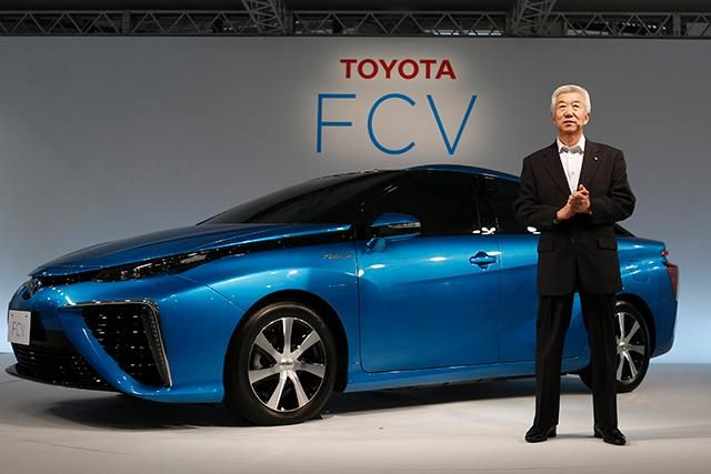 Toyota Motor' executive vice president Mitsuhisa Kato speaks in front of the company's prototype fuel cell vehicle sedan car today