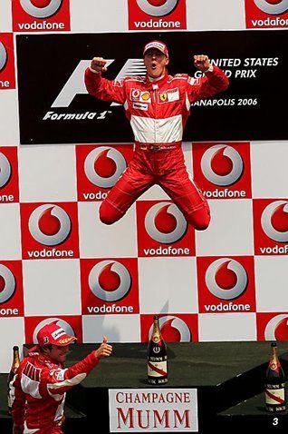 Race winner Michael Schumacher (GER) Ferrari celebrates on the podium.  Formula One World Championship, Rd 10, United States Grand Prix, Race, Indianapolis, USA, 2 July 2006