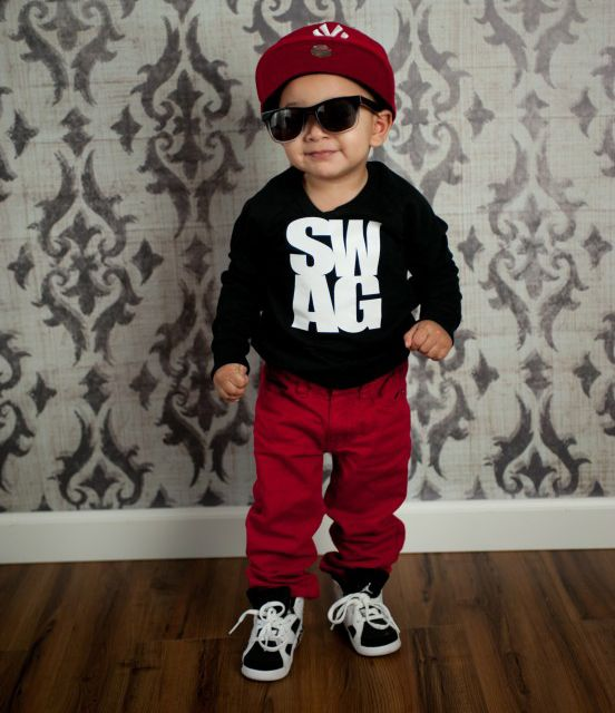 This is a cute kid but It's funny when young adults still dress like this. SMH.