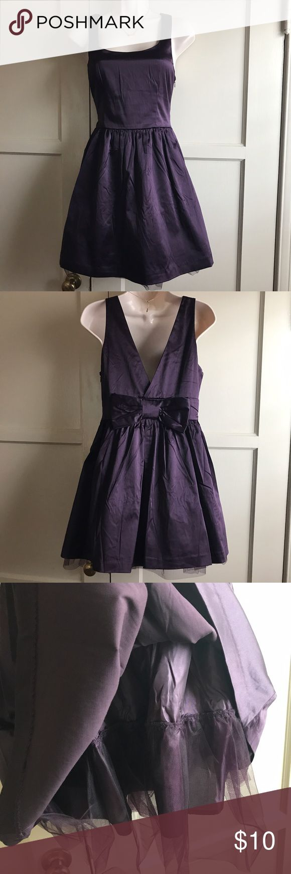Forever 21 purple skater dress NWT. Cute silk like skater dress with under lining with tulle. Deep V-neck back cut with bow. I purchased it wrinkled (probably when the associates took it out of the box). Forever 21 Dresses Midi