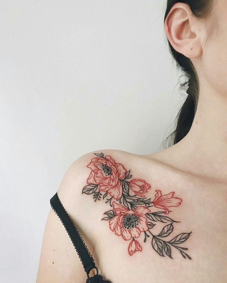Black and red flower tattoo on the right shoulder and clavicle