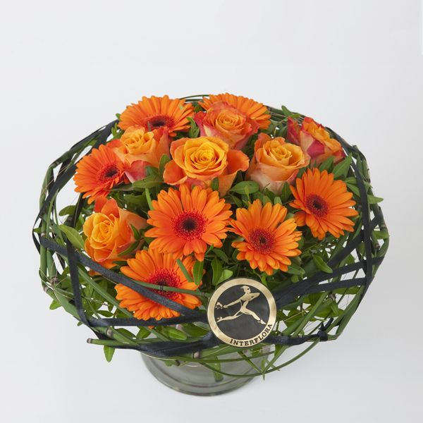 Wow Lav og tett bukett med orange roser og germini fra Interflora. Om denne nettbutikken: http://nettbutikknytt.no/interflora-no/