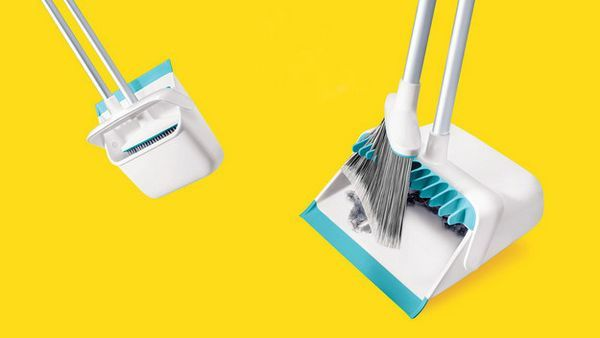 A dust pan that cleans your broom for you