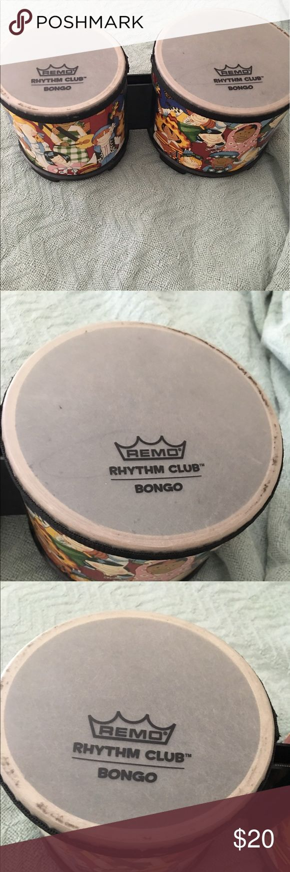 ❤️BONGOS BY REMO!❤️ Selling bongos by Remo! In great condition with the exception of a scribble on the top. Looks like some dirt build up inside the rims of drums. No stand for these. Sound is great on these for little ones! remo Accessories