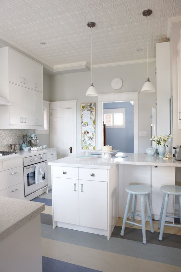 white, gray and blue kitchen