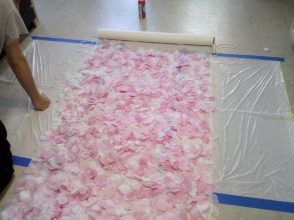 Rose Petal Aisle Runner  Use spray adhesive layering the petals to give it more of a  3D look and not so flat...  It's been time consuming but not as long as sewing or hot gluing each petal would.