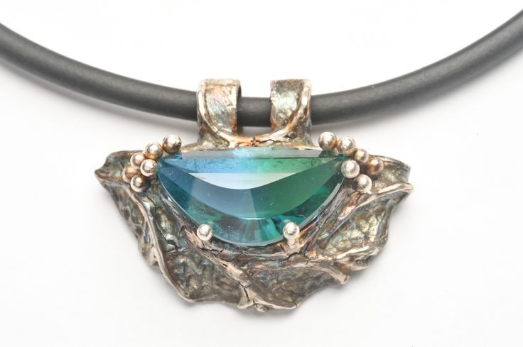 Art Clay Silver pendant set with a bi-colour lab-grown quartz fancy cut stone. Artist: Alan Samons – South Africa. Pendant 2009