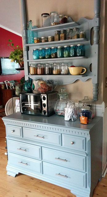 Shelf for kitchen made from headboard and footboard.  Dresser used for drawer storage.