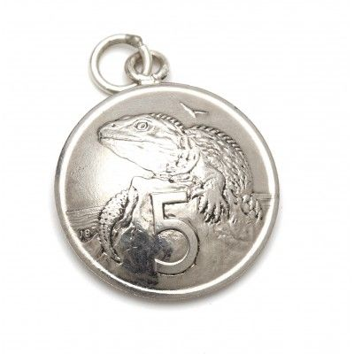 Vintage Coin Charm Five Cent. This five cent vintage coin charm has been silver dipped and looks great added to silver charm bracelets or hung on a Stirling silver chain. It is hand crafted from vintage New Zealand currency no longer in circulation. The five cent coin is approximately 19mm in diameter and features New Zealand's living dinosaur the Tuatara on the front and Queen Elizabeth the Second on the back. Made in New Zealand.  See more at www.entirelynz.co.nz/gifts