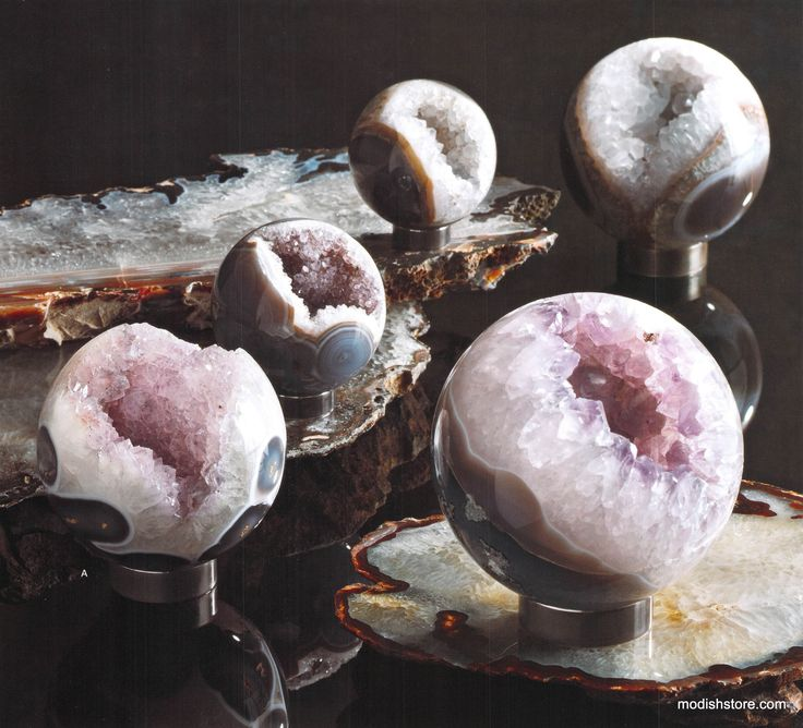 Roost Amethyst Spheres: Our highest grade amethyst geodes from Brazil are cut and shaped into perfect highly polished spheres. These orbs have dense amethyst crystal pockets of milky white, blue gray, slate and mauve crystal formations, some with pink accents. Rich veins of color are exposed on the polished exteriors.