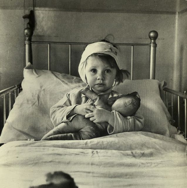 Three year old Eileen Dunne in her bed at the Great Ormond Street Hospital for Sick Children. She was injured in an air raid on London in September 1940