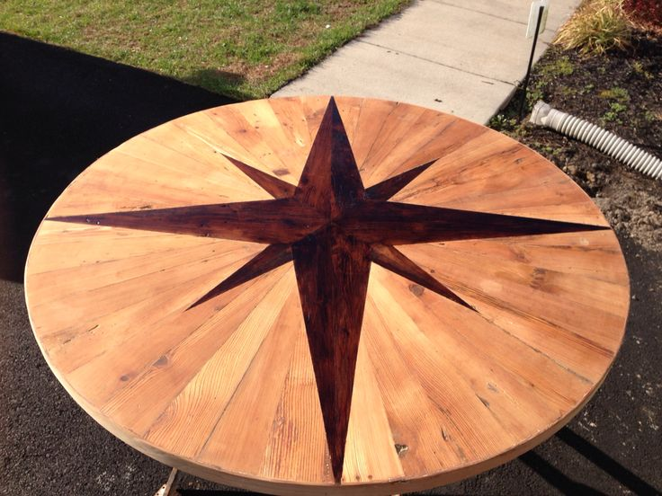 "4'6"" round table from reclaimed wood with a compass rose insert"