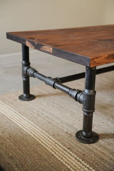 Black iron pipe and reclaimed wood table.