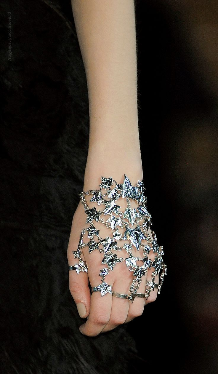 I like the unconventional placement for this piece–on the hand rather than the wrist–as well as the intricacy.