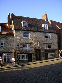 Jew's Court, The oldest synagogue in the British Isles, a Norman building it is immediately above The Jew's house and dates between 1150 and 1180. It is probably the only standing medieval Synagogue in UK. It is still in use and part of it operates as a book shop