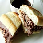 Slow Cooker French Dip: Economical Version, Reduced Cooking, Roast Simmered, Old Favorite Sandwich, Onion Soups, Cooking Liquid, Sauce, Beef Broth