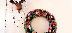 Fed up with your boring ol' traditional holiday wreath? Ditch the greenery and go extra festive this year with this felt ball wreath HowTo, courtesy of Norwegian craft blog Pickles.    P.S. You'll need to know how to make felted balls, which Pickles was kind enough to demonstrate, as well: