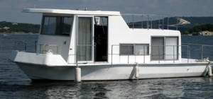 A clean looking Fisher Craft houseboat. Can anyone tell me if Fisher Craft Houseboats made a good, solid, small house boat? I can't seem to find very much information on them. I am looking
