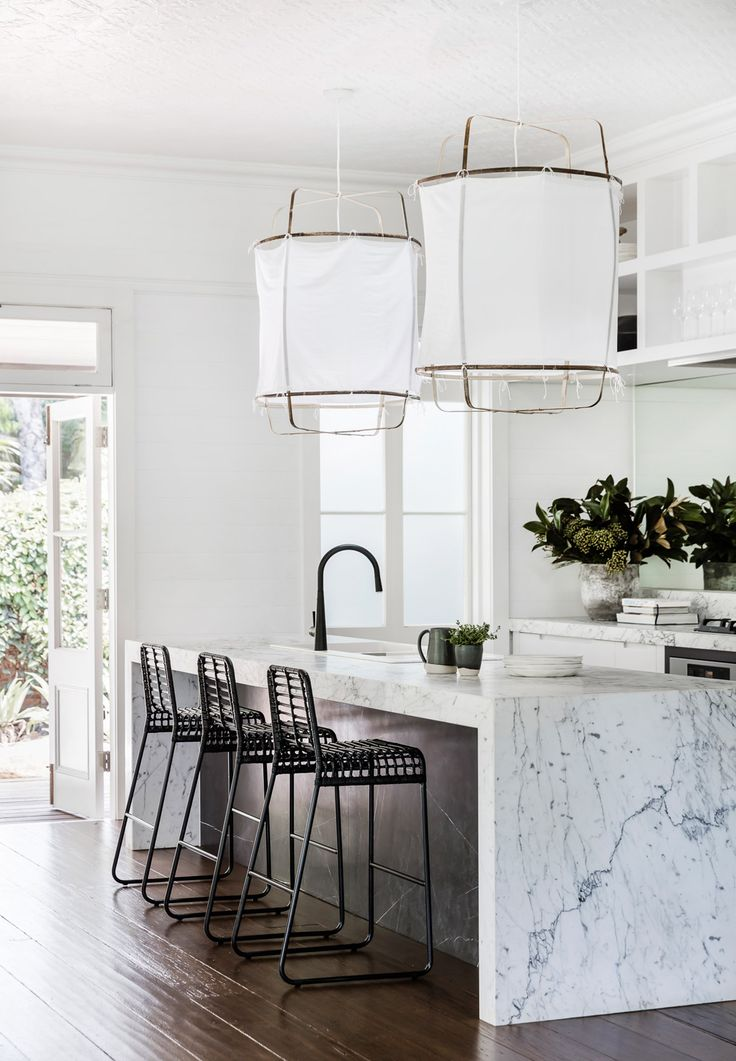 marble waterfall kitchen counter and big fabric pendants | earthy modern house tour on coco kelley