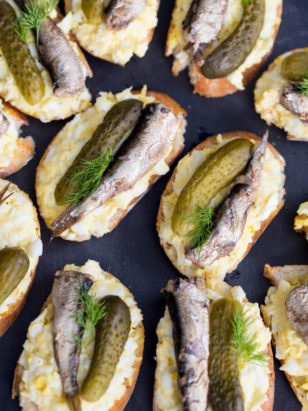 Updated December 28, 2014. These sandwiches are very unique and often receive a lot of attention at parties. The ingredients that are combined together, create the perfect bite of flavors. Our boys are huge fans of those sandwiches, they often ask to add more fish to theirs. Smoked canned sprats are common in European countries. They can be found in many European markets. If you don't have access to them, you can replace them with any other canned fish.