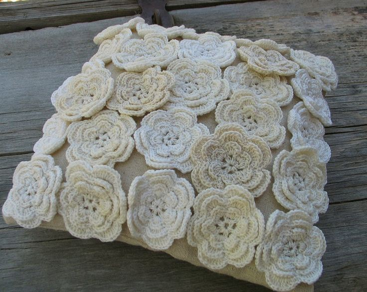 What an inspiring pillow!  I have an assortment of tiny crocheted flowers and now I know what I'm going to do with them!  Thank you for the inspiration.