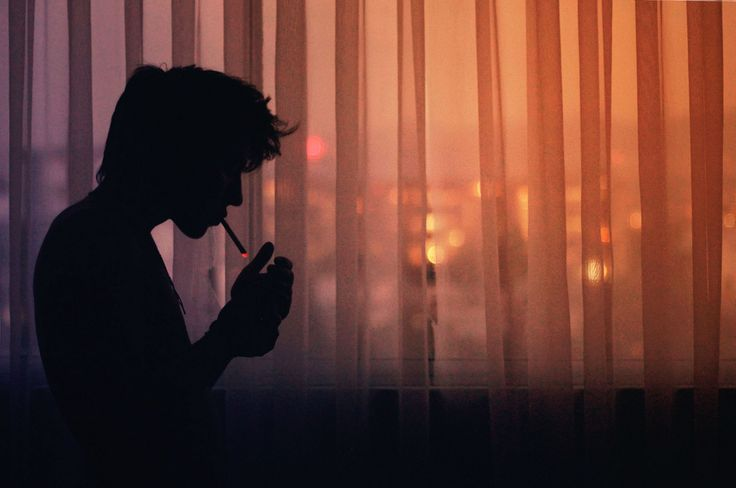 Donnie, smoking, lighting, cigarette, curtain, city, silhouette
