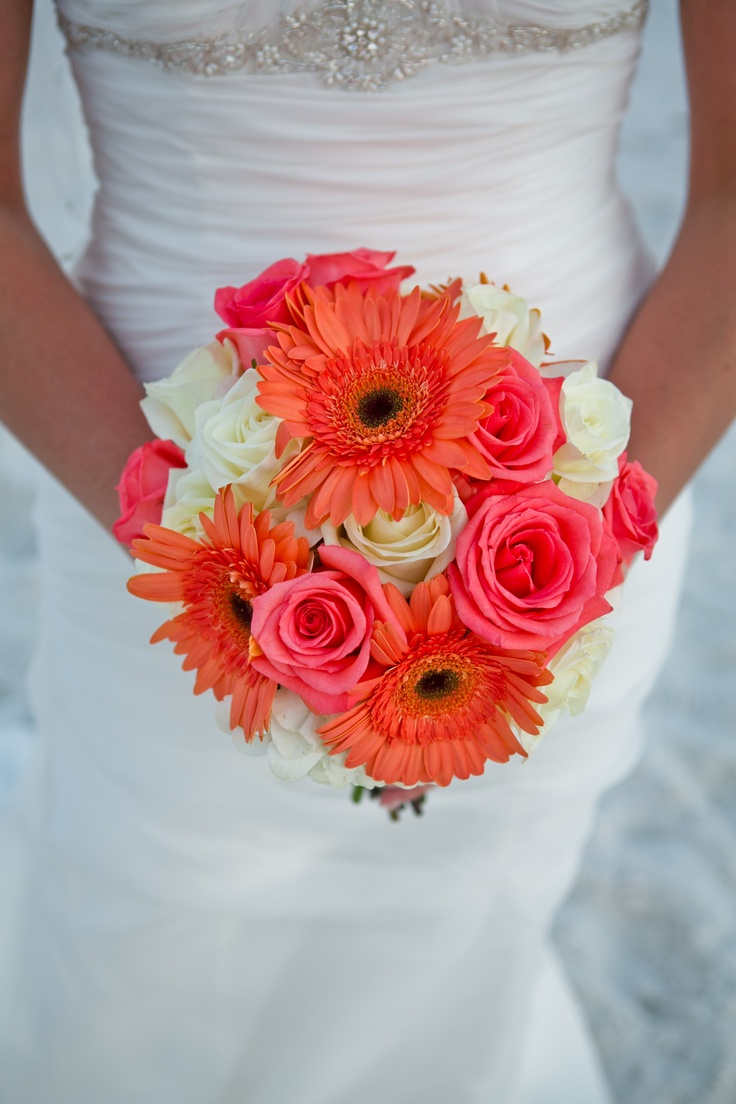 My wedding bouquet - base of white hydrangeas with white and pink roses and coral gerber daisies!