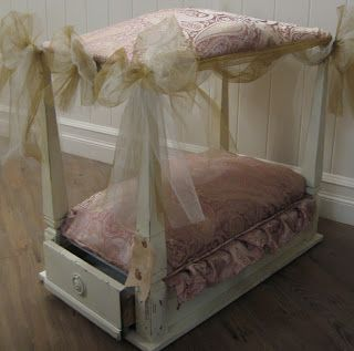 This is fabulous- take an old end table, turn it upside down, and make a beautiful pet bed w/storage! Click for tutorial.