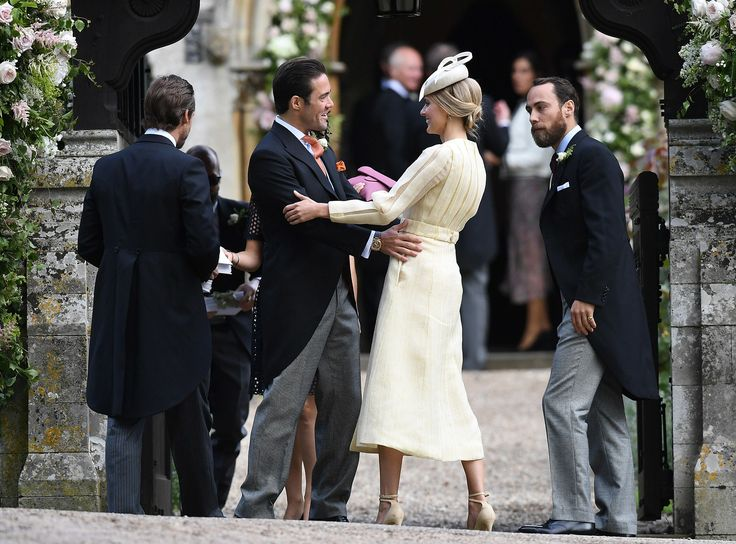 ENGLEFIELD GREEN, ENGLAND - MAY 20:  Spencer Matthews brother of James Matthews, greets Donna Air as she attends the wedding of Pippa Middleton and James Matthews at St Mark's Church on May 20, 2017 in Englefield Green, England.  (Photo by Samir Hussein/Samir Hussein/WireImage) via @AOL_Lifestyle Read more: https://www.aol.com/article/lifestyle/2017/05/22/meghan-markle-dress-pippa-wedding/22103437/?a_dgi=aolshare_pinterest#fullscreen