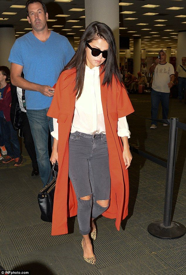 What's wrong? Selena Gomez tweeted that was feeling down in the dumps when she arrived at Miami airport on Saturday evening