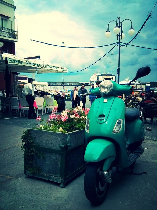 Capri, Italy — by Brenny Cakes. An Italian Vespa on the waterfront on the famous Isle of Capri!