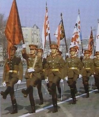 The color guards of the Hungarian People's Army guard of honor trooping the historical flags of Hungary through Procession Square in the Budapest City Park at the 1985 Hungarian Liberation Day Parade.