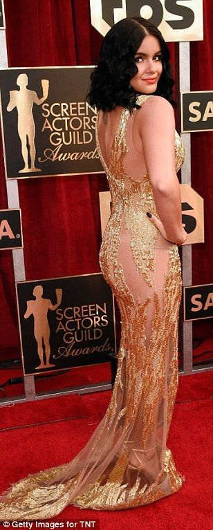 Modern gal! Ariel was a golden goddess in a sequinned Mikael D gown with sheer portions...