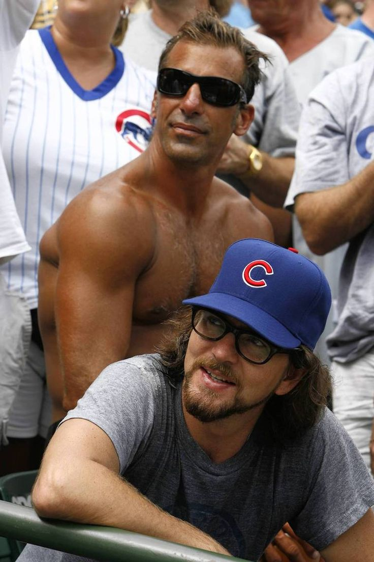 Eddie with shirtless NHLer Chris Chelios at a Cubs game in 2008.