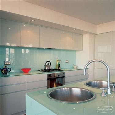 French blue splashback - high gloss white kitchen cabinets. No handles.