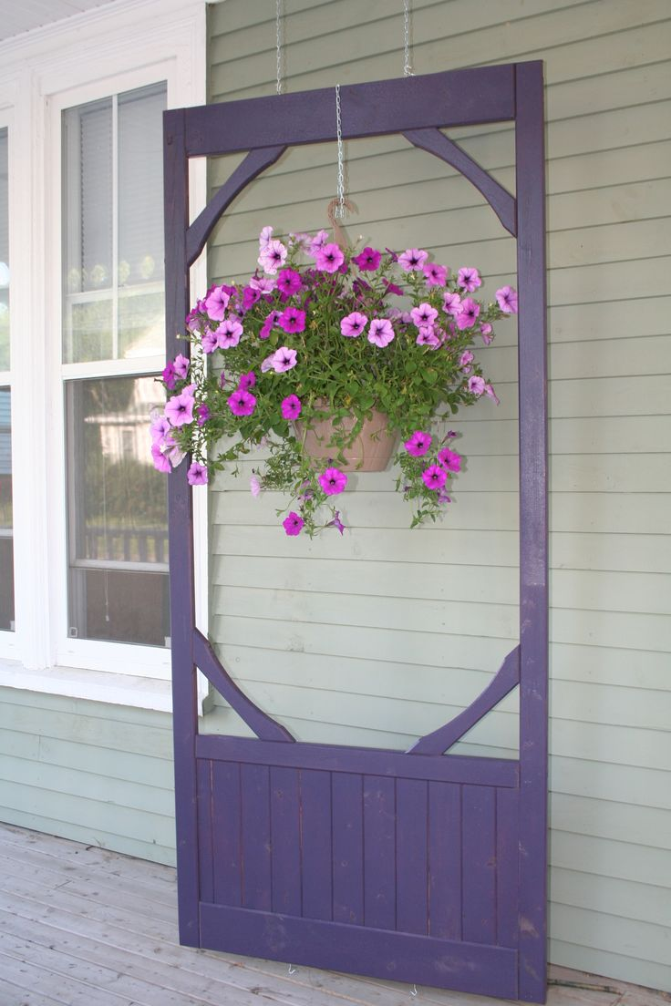 I didn't know what to do with an old screen  door I had bought for $10, it didn't fit any door so I thought this might work. Turned out pretty good. Spray painted purple, which looks good against a grey/green house.