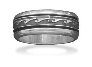 Wave Design Sterling Silver Spin Ring: This awesome brand new men's spin ring is a genuine stamped .925 sterling silver ring with a 8.5 millimeter wide band and an oxidized finish wave design. This ring is available in whole sizes 6, 7, 8, 9, 10, 11, 12 and 13 (US)  All buyers are contacted upon payment verification to confirm their desired ring size prior to shipping and international buyers are welcome to contact us for a ring size conversion chart to determine their correct corresponding…
