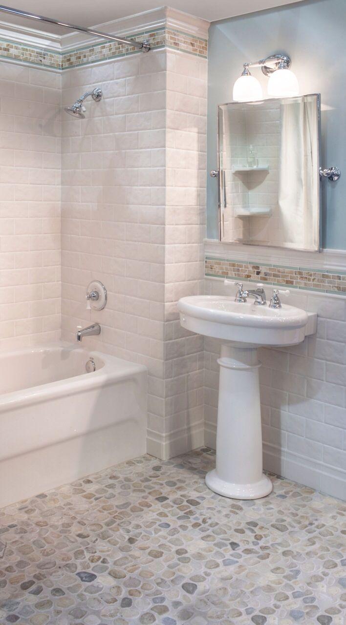 Sea green and white pebble tile bathroom floor