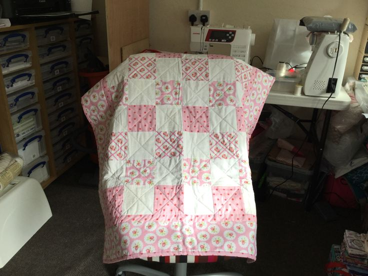 Pink crib size quilt