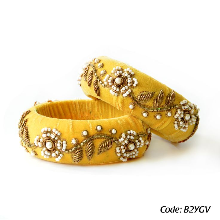 Rusaru Yellow Velvet Bangle: Highlight your outfits with this beautifully handcrafted bangle. Done with delicate pearl and zardosi work on yellow pure velvet base, this elegant design will definitely jazz up your outfits. Visit: www.facebook.com/rusaruaccessories