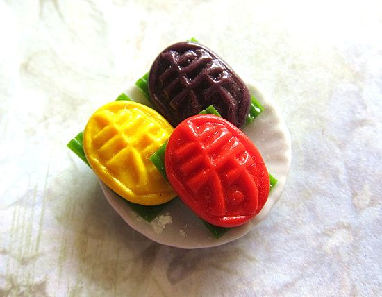 3 Pieces Colorful Ang Ku Kueh On Round Plate